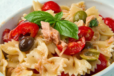 simple and super easy baby shower food ideas, dessert inspirations - pasta salad with tuna, tomatos, and olives