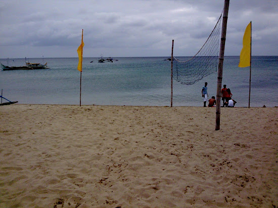 Beach volleyball net at Laiaya Aplaya