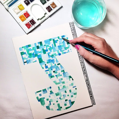 Geometric watercolor painting of the letter J in blue and green