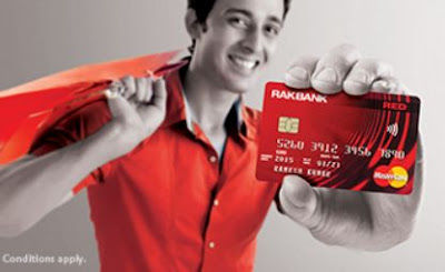 Man holding the RAKBANK RED MasterCard Credit Card.
