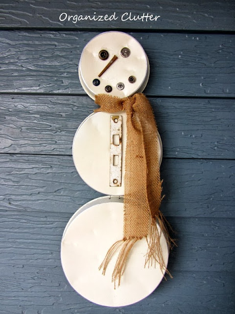 Repurposed Cake Pan Snowman http://organizedclutterqueen.blogspot.com/2013/10/re-purposed-cake-pan-snowman.html