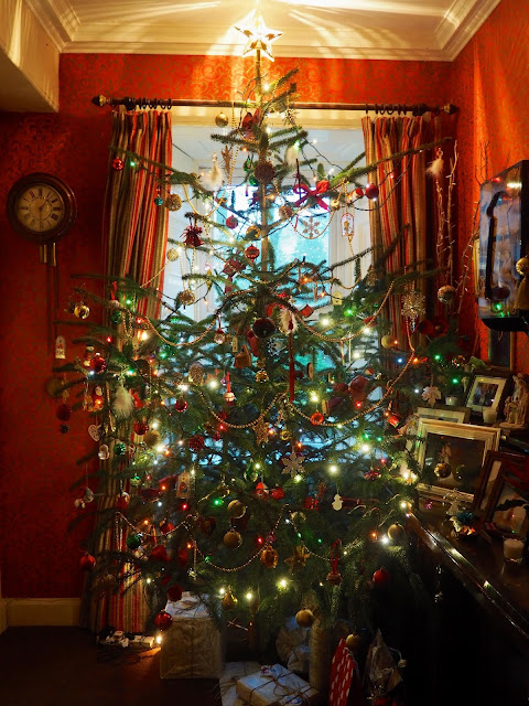 This year's Christmas tree, decorated with ornaments, lights, baubles and a star on top