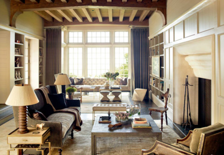 The Drapes Hung Between Two Seating Areas Help Create Two Sitting Areas In  This Large Room