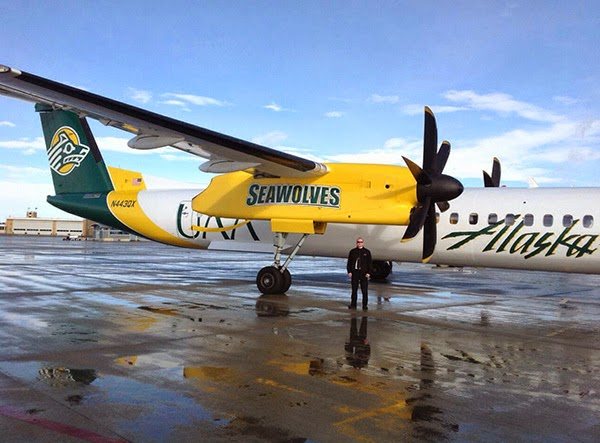 UAA alumnus Tony Barton is a pilot for Horizon Air, which owns this Q400 turboprop painted with Seawolves' colors and logo.