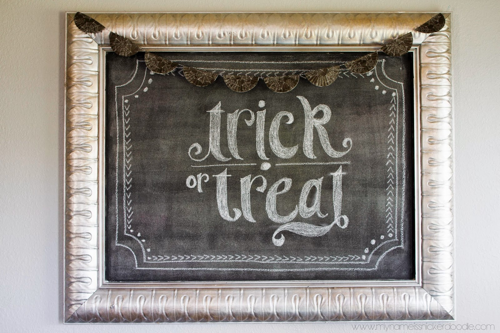 Loving my spiderweb cupcake liner banner over my favorite chalkboard!  DIY on my site!  | My Name Is Snickerdoodle