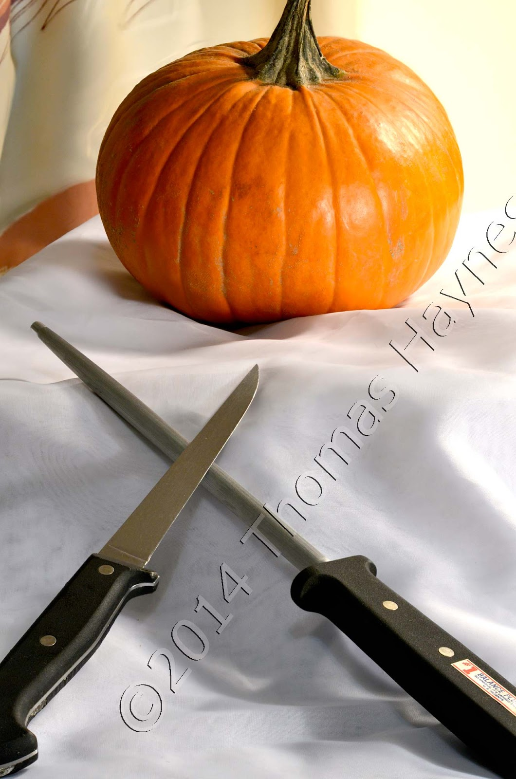 pumpkin with knife and sharpening steel
