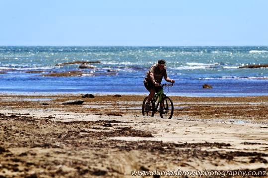 Biker on the beach photograph