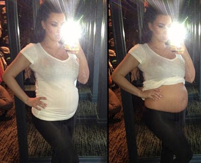 Kim Kardashian shows pregnant belly