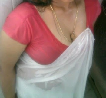 Hot malayali aunty in white saree with a golden chain picture | Hot ...