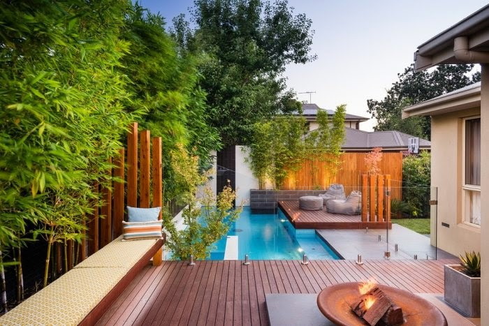 Outdoor pool with modern wooden deck