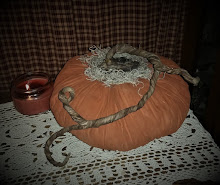 LARGE PRIMITIVE PUMPKIN WITH TRAILING VINE