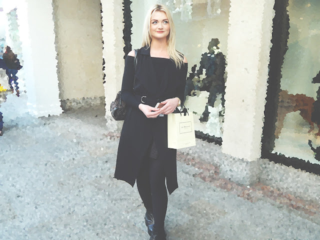 Blonde girl in an all black outfit