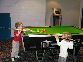 game of pool inexpertly played by 5 year olds