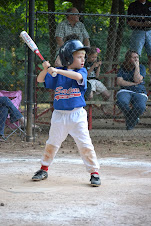 Elijah playing baseball
