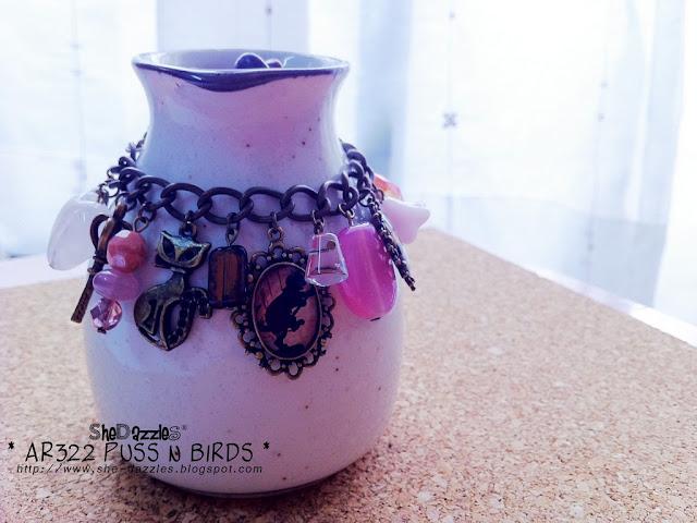 pink-resin-pendant-silhoutte-charm-bracelet