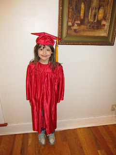 Curly in red cap and gown