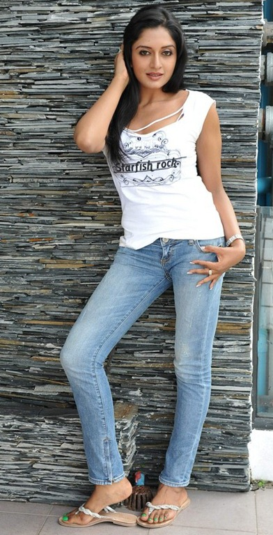 Vimala Raman Pictures in Torn Starfish Rock T-shirt & faded jeans