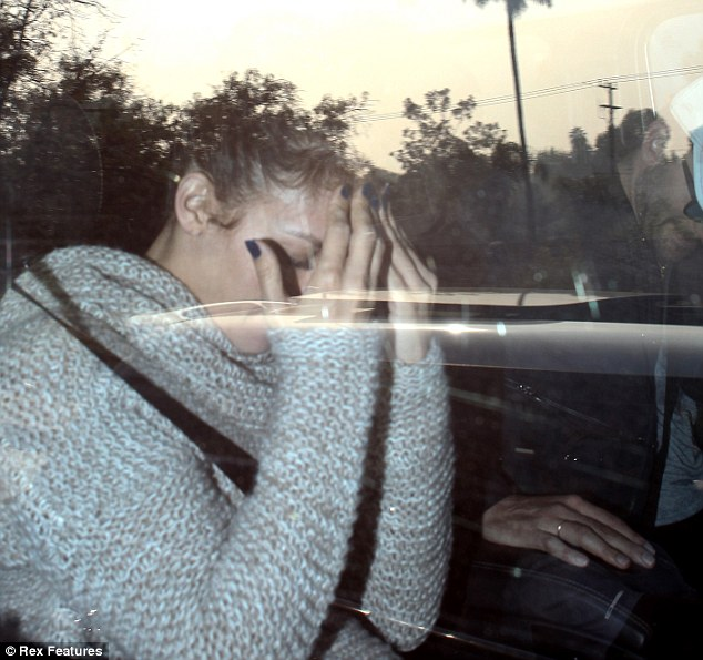 Jennifer Lopez shields her face after being caught out with Bradley Cooper