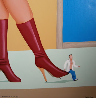 A woman wearing bright red, knee high stiletto boots and kicking a small man wearing a white shirt and jeans up the bottom.