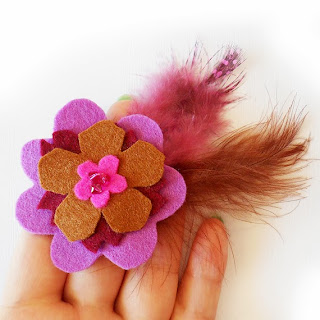 https://www.etsy.com/listing/166770605/felt-flower-clip-with-feathers-in-brown