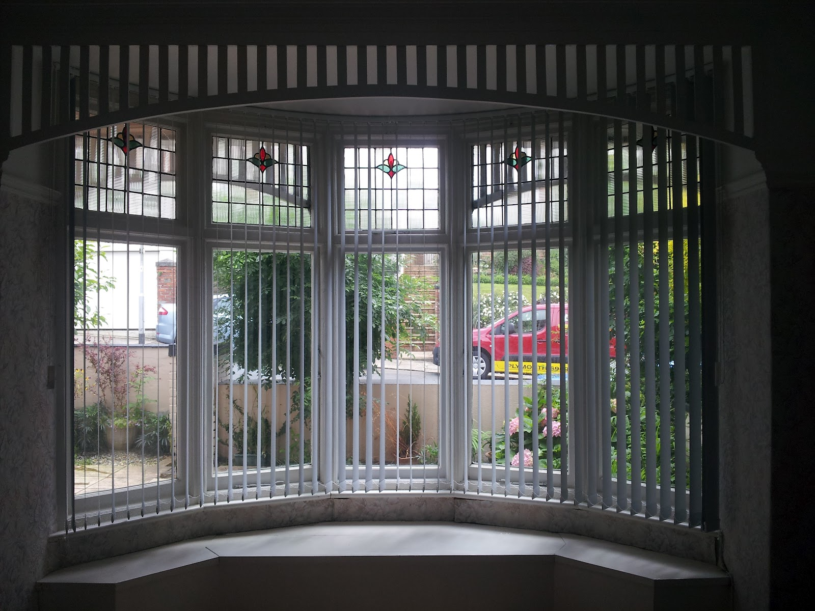Blindology blinds of plymouth curved vertical window for Curved bay window