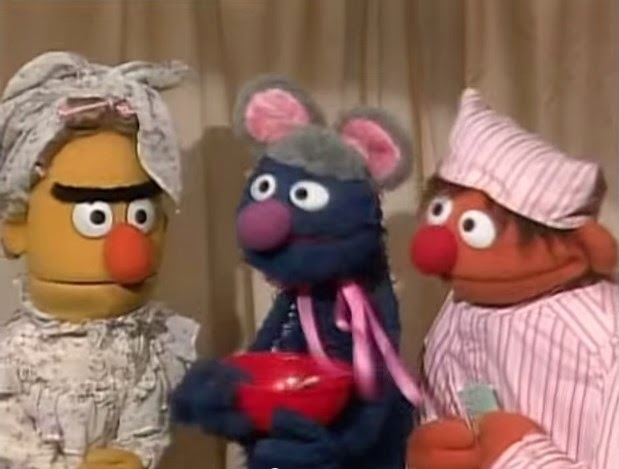 the sesame street gangs christmas pageant features the night before christmas note how grover is not stirring in his role as the mouse - Muppets Family Christmas