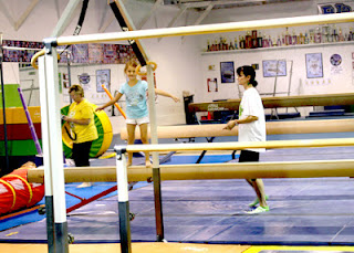 Tessa on balance beam during summer camp.