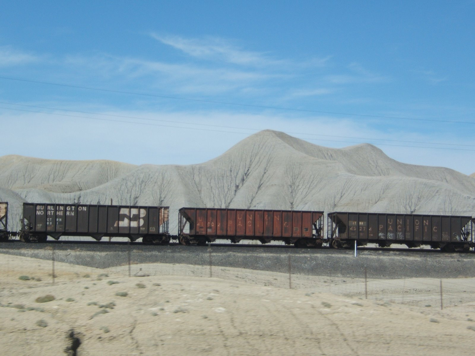 Train cars side tracked. Utah desert, Between Price and Green River. © 2009 Tina M Welter