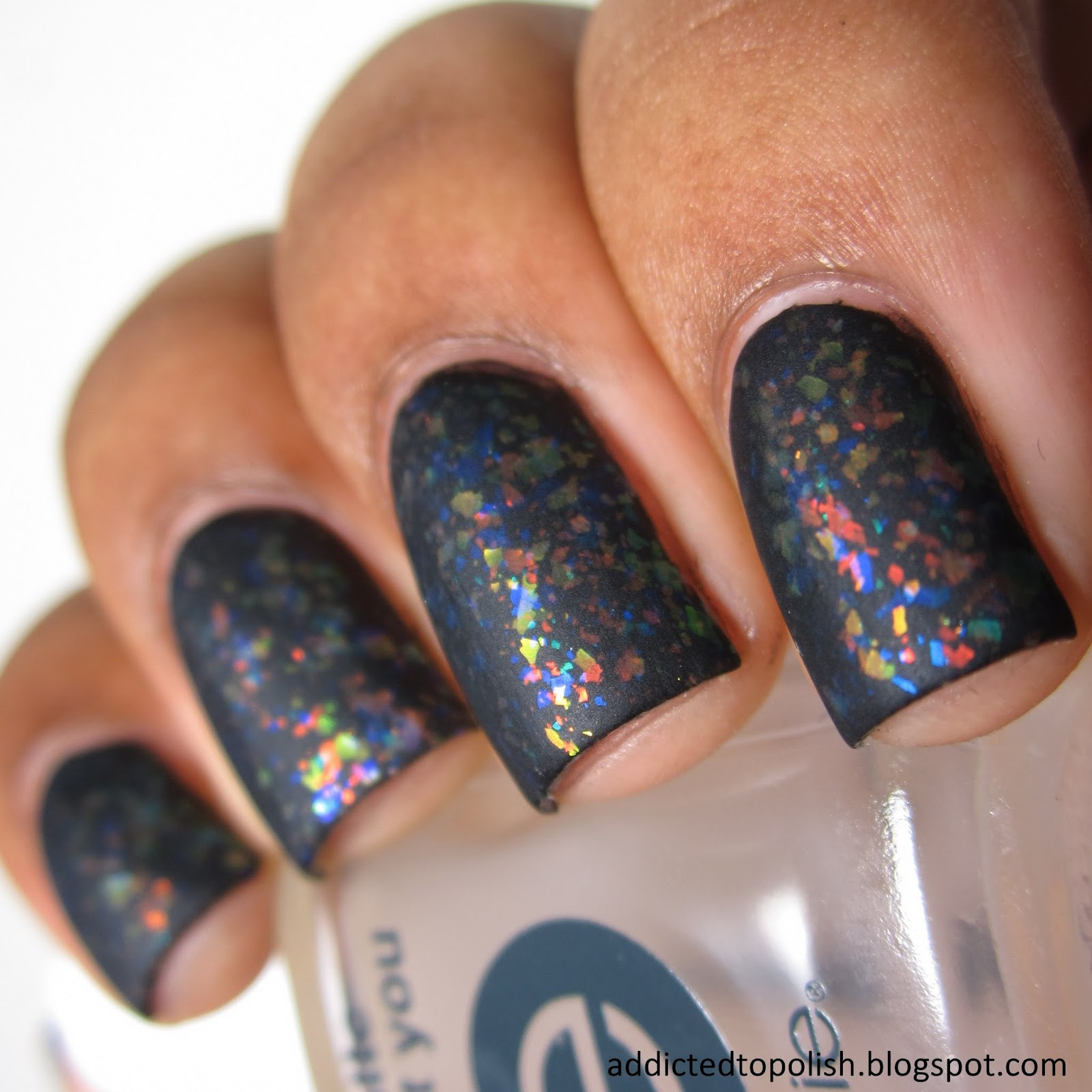 Finger Paints Twisted over black matte flakie