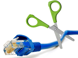 This is a picture of a scissor cutting an Ethernet cable, a cable that connects you to the internet.