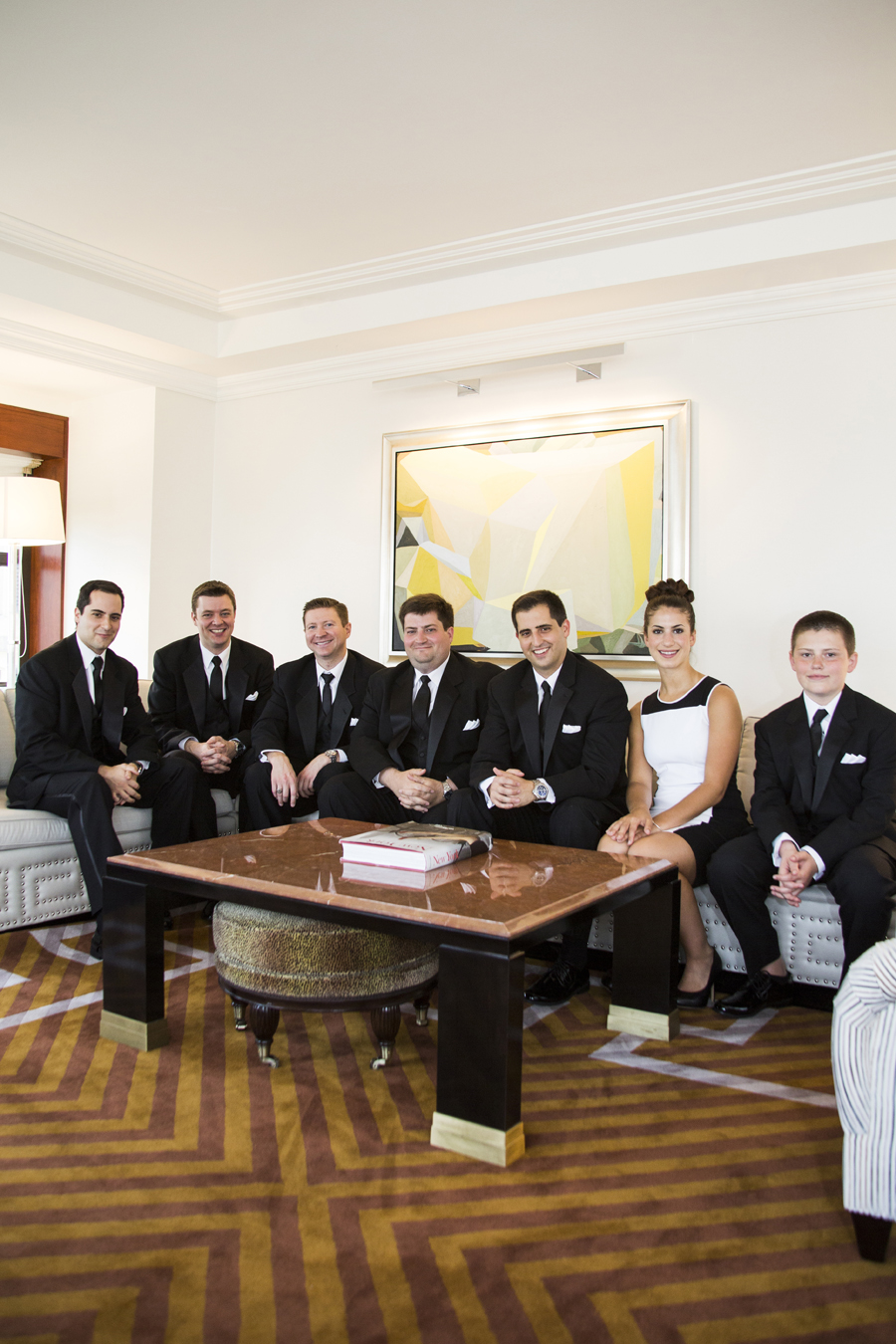 happy groomsmen and groom in New york Palace hotel room before wedding ceremony