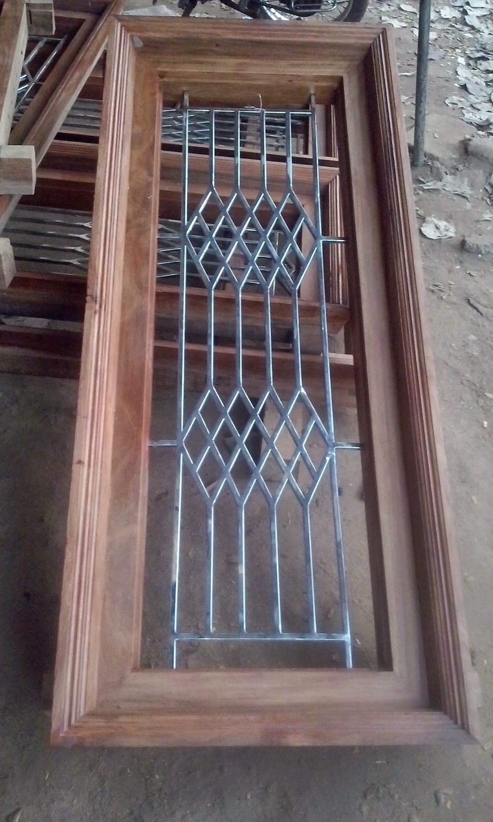 Kerala style carpenter works and designs february 2015 for Window design grill