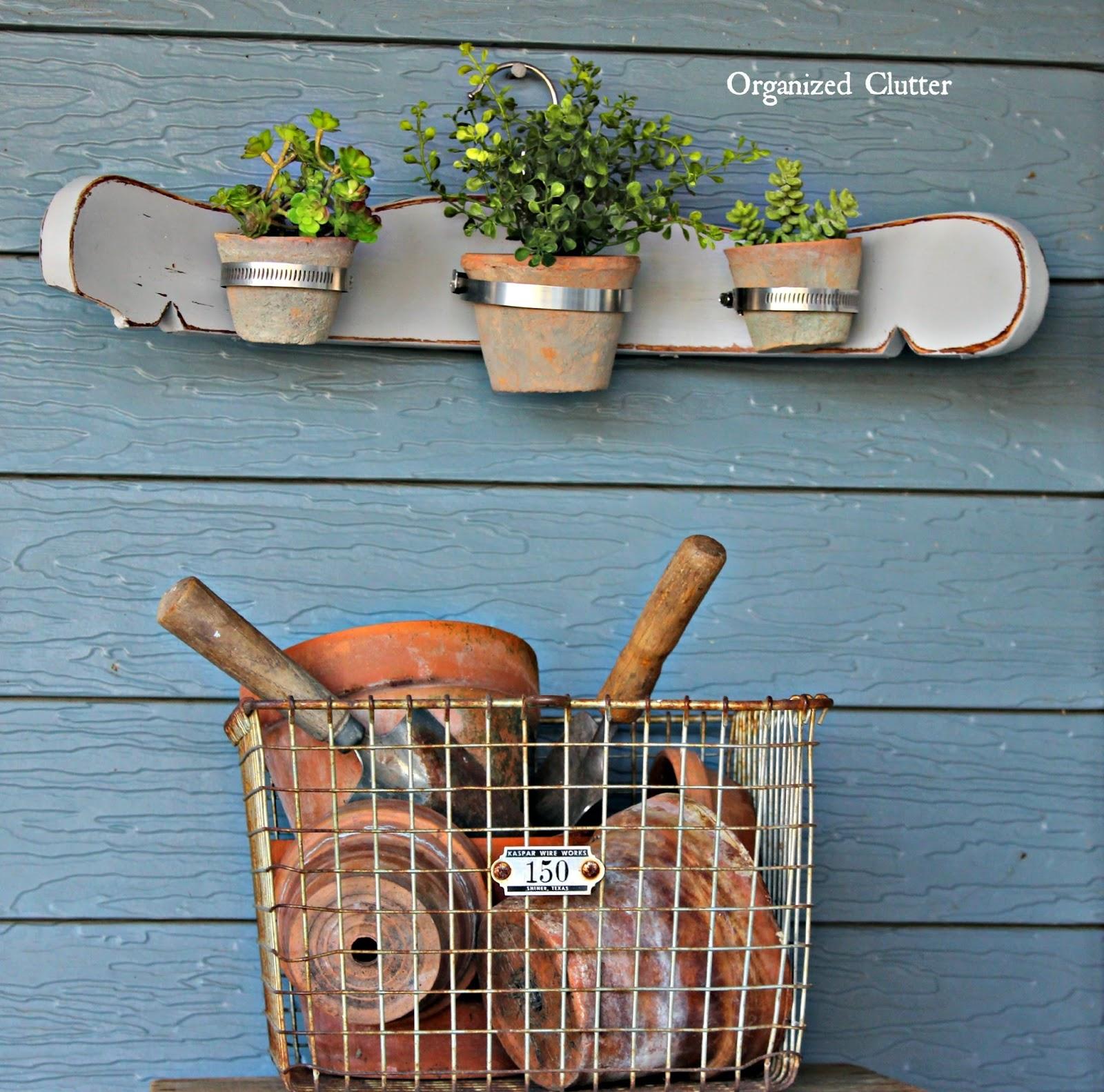 Re-purposed Chair Back Terracotta Pot Display www.organizedclutter.net