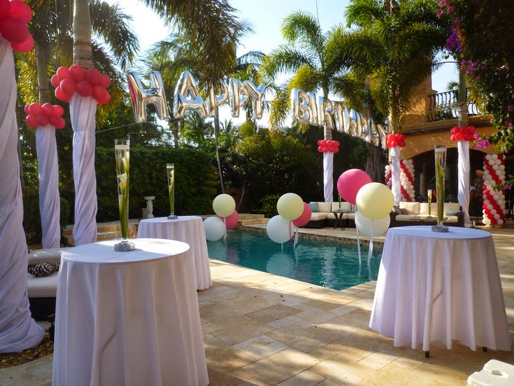 Backyard party decoration Balloon column, palm tree draping, HAPPY