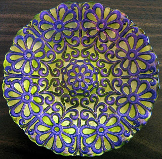 http://www.decorativedishes.net/purple-on-green-iridescent-art-glass-flower-power-exotic-plate/