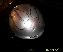 Purple custom painted flames on a helmet