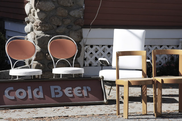 photo of cold beer sign at antique store