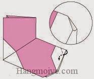 Bước 13: Gấp góc giấy vào trong giữa hai lớp giấy.