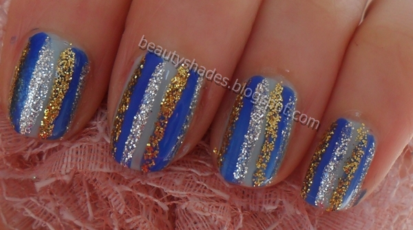 I did a video tutorial of this nail art design on my youtube channel Here