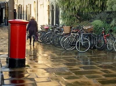English street rain paving letterbox bicycles