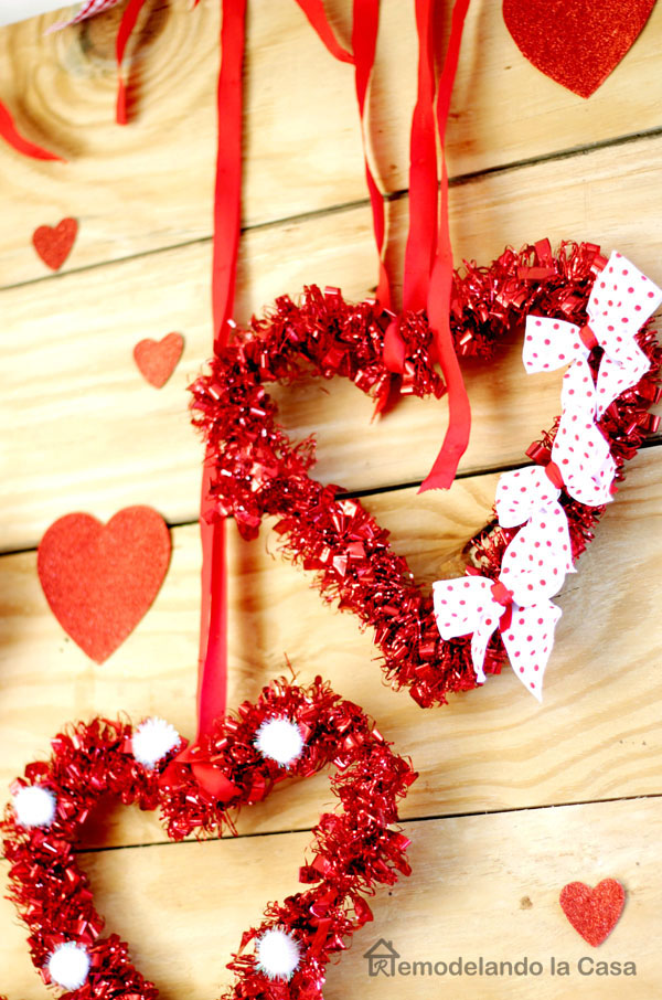 hearts with pom poms, bows, ribbon red