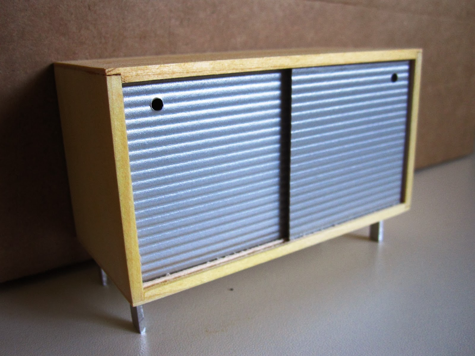 Mod Pod Miniatures' retro credenza with grey sliding doors