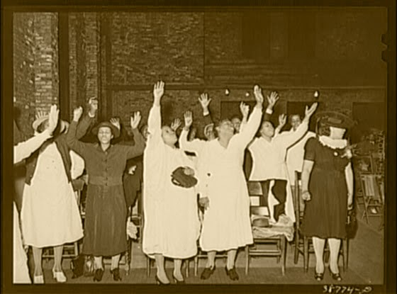 Public Domain Image:  Women in a Pentecostal worship service.