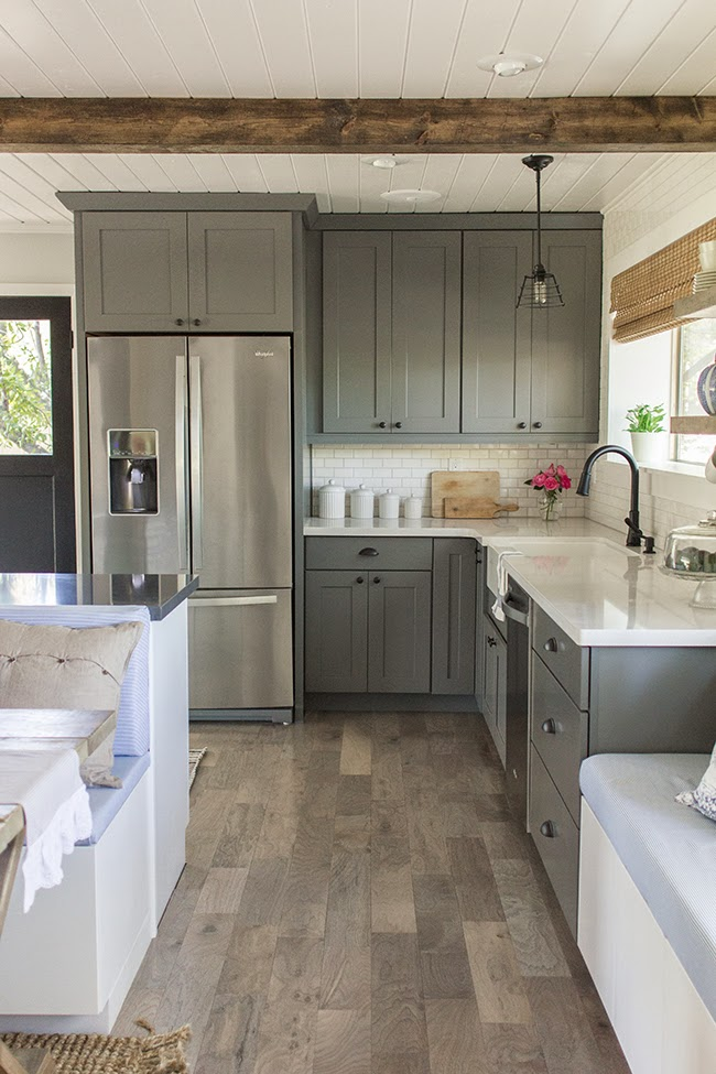 Beautiful Remodeled Kitchen With Gray Cabinets And White Subway Tile.