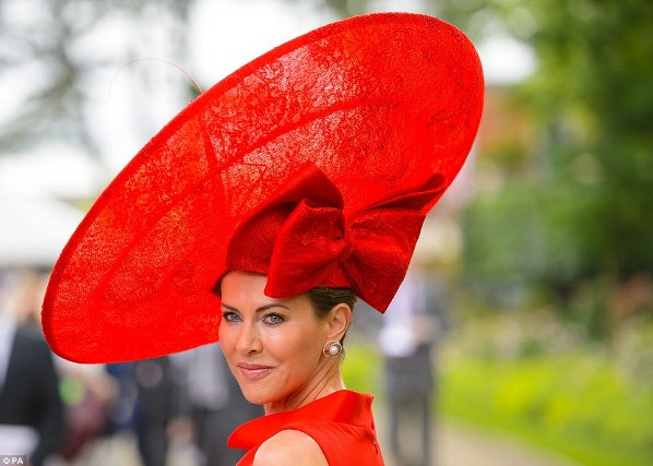 Belinda Stradwick shows off her incredible crimson lace hat, topped with feather trim and embellished with an oversized bow on day 2 at Royal Ascot, 2014