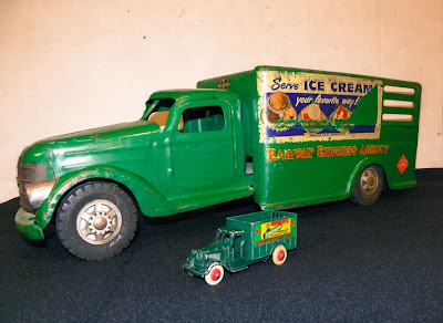 green antique toy truck