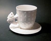 Krūze + tase- kaula porcelāns, apzeltījums. Cena: 53 Ls