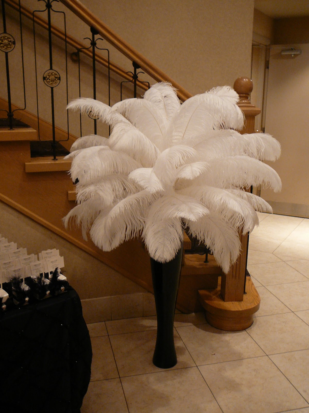 Flower and event decor ostrich feather centerpieces best decor very tall and elegant feather arrangement that was later on moved to the sweet table reviewsmspy