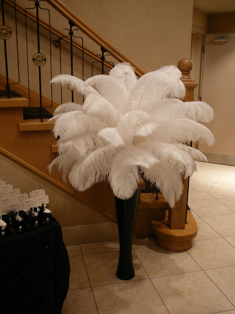 Flower and event decor ostrich feather centerpieces best for Creative things to put in vases