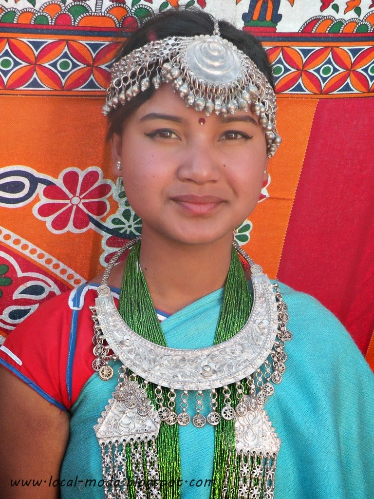 Nepali Tharu girl wearing traditional head ornament and necklace